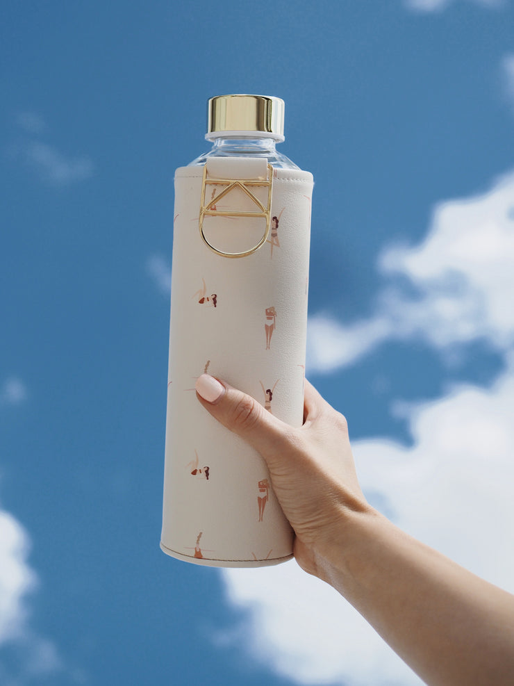 EQUA glass water bottle Playa with golden details with sky background