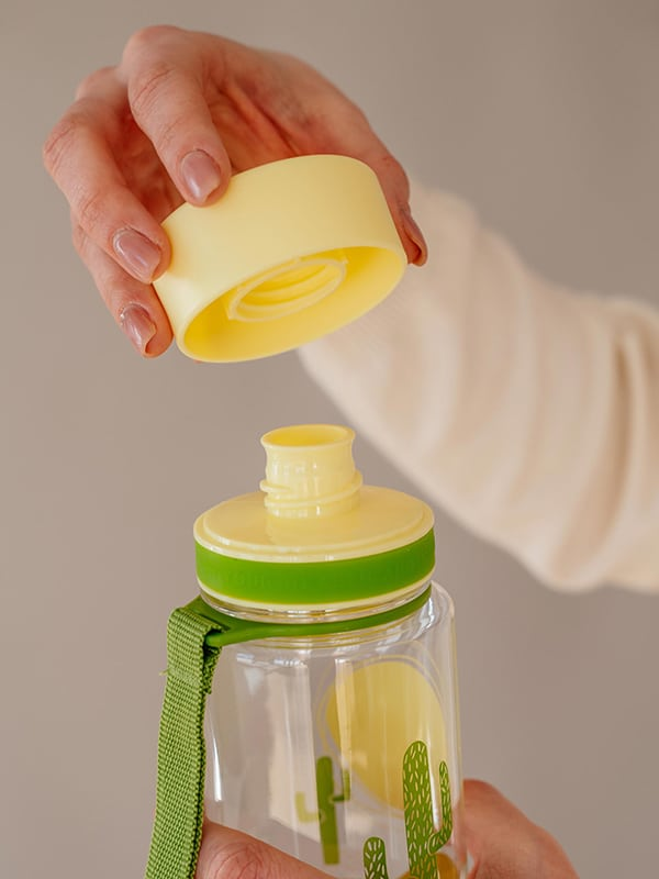 EQUA BPA FREE water bottle, Chameleon, close up of the lid and mouth piece, yellow and green color