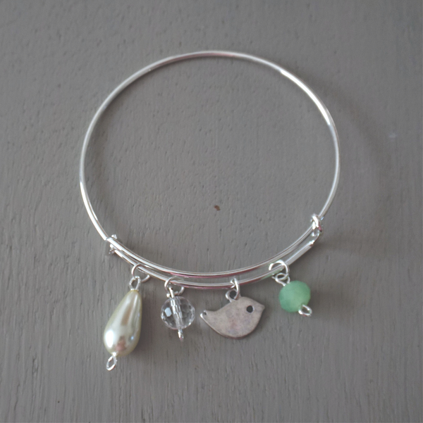 Adjustable silver plated bangle with birdie charm, ivory & green beads