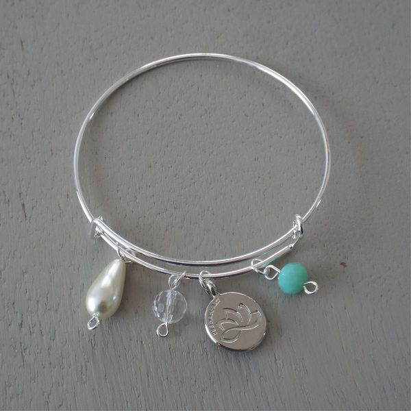 Adjustable silver plated bangle with lotus disc charm & soft mint rondelle