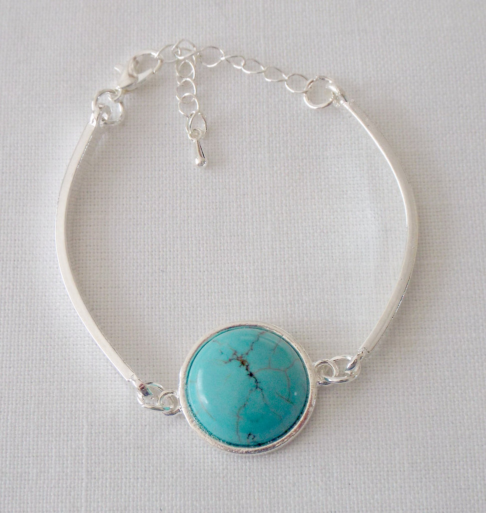 Silver plated bar bracelet with 18mm turquoise howlite gem