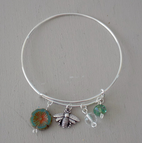 Adjustable bangle with silver plated bee charm, green beads