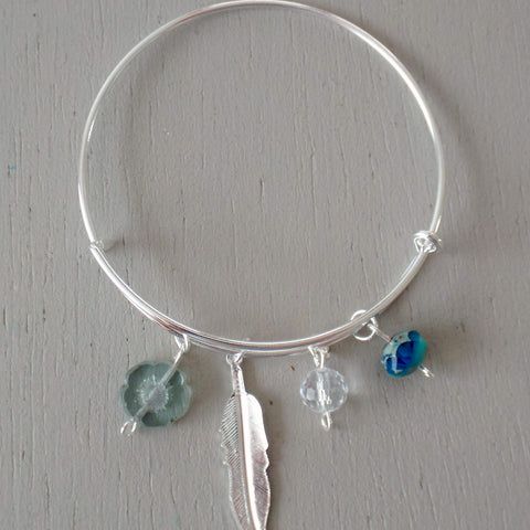 Adjustable bangle with bright silver plated feather charm & aqua / seagreen beads