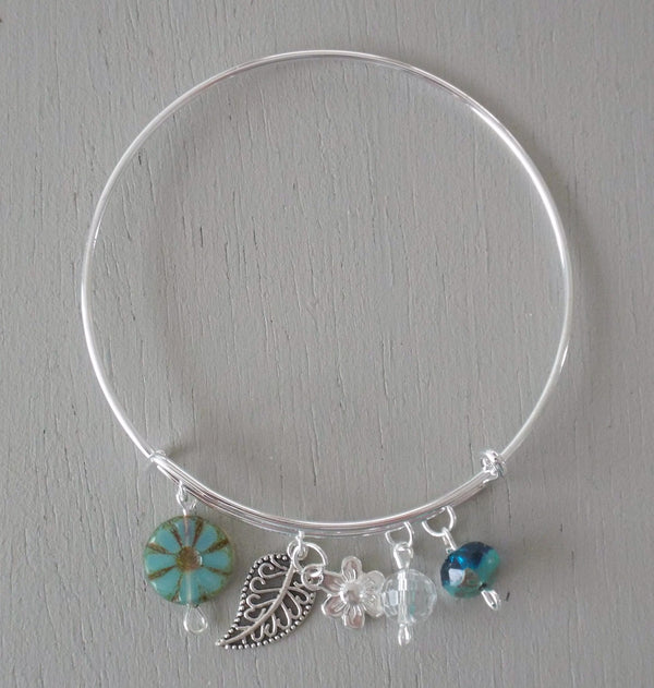 Adjustable bangle, silver plated filigree leaf & flower charms, seagreen beads
