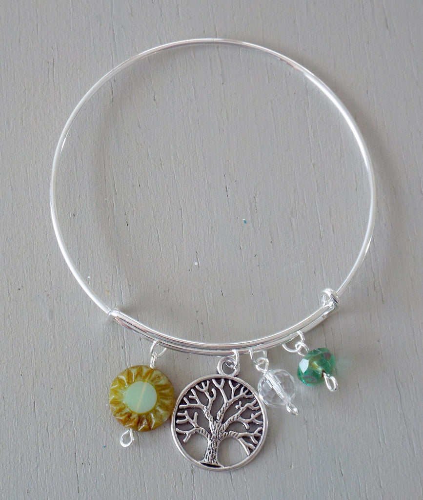 Adjustable bangle with silver plated tree-of-life charm, green beads