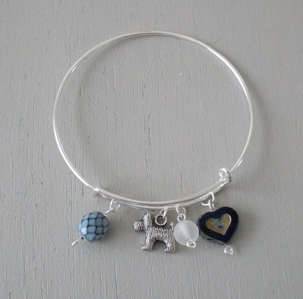 Adjustable sliver plated bangle with dog charm, blue accents