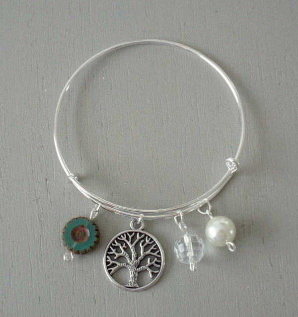 Adjustable silver plated bangle with tree of life charm with green and pearl beads