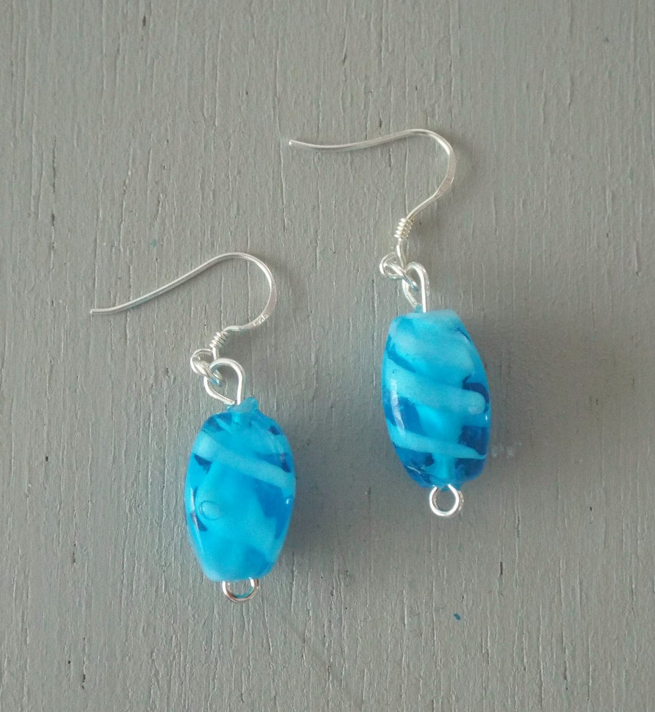 Earrings with blue & white swirl lozenges