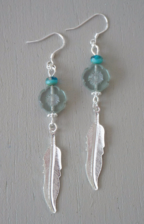 Earrings with bright silver plated feather charms, aqua / seagreen beads