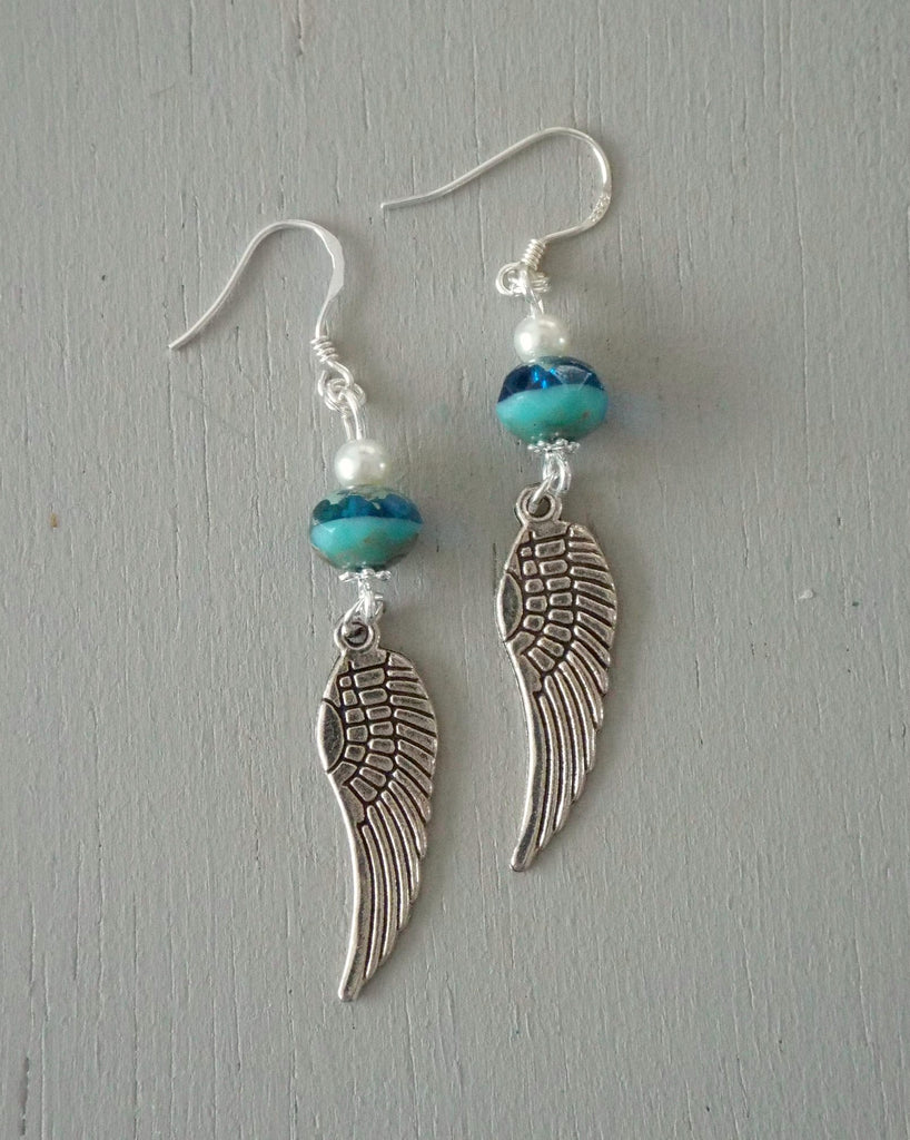 Earrings with silver angel wings with sea green & ivory beads