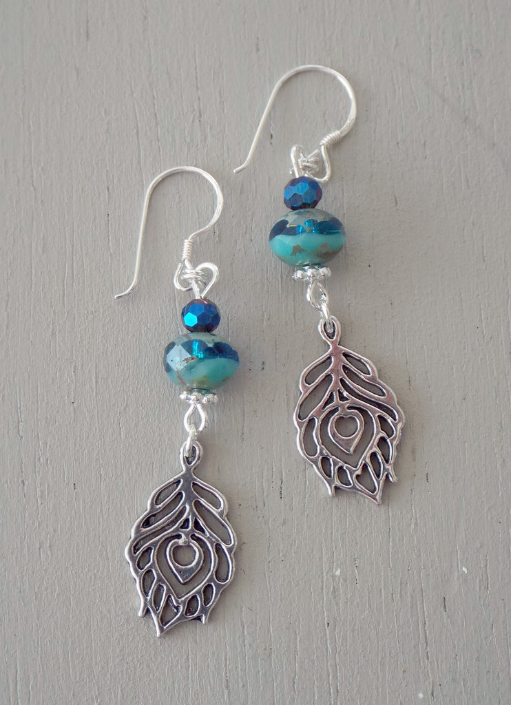 Earrings with peacock feathers, sea green rondelles & midnight minis