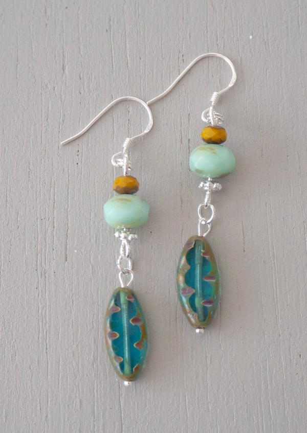 Earrings with teal carved ovals, mint rondelles & mustard minis