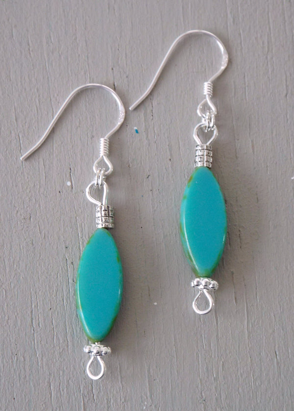 Earrings with turquoise ovals & silver spacer