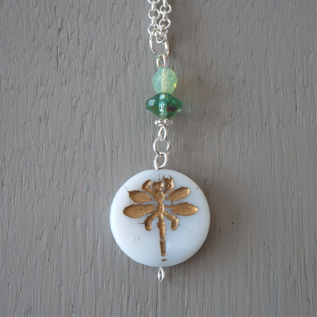Pendant - 22mm white & gold-carved dragonfly disc, green bead accents