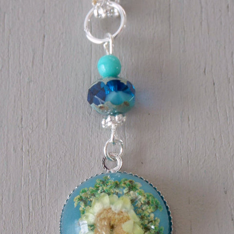 Pendant with 18mm blue & yellow floral focal, sea green accents