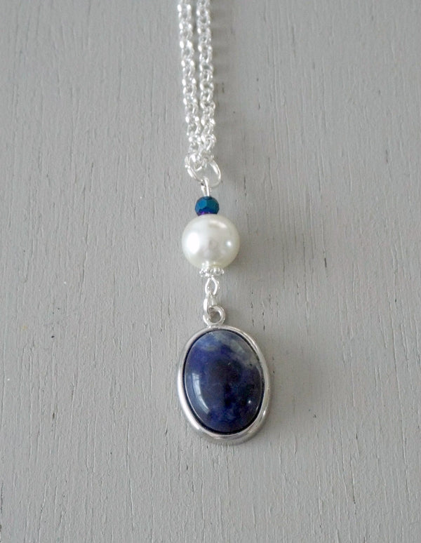 Pendant with 18x13mm blue sodalite focal, ivory pearl / sparkly midnight mini