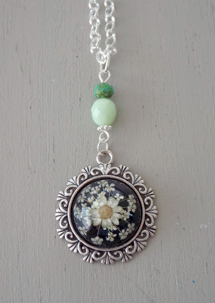 Pendant with 20mm black & yellow floral focal, ornate setting, mint & green beads