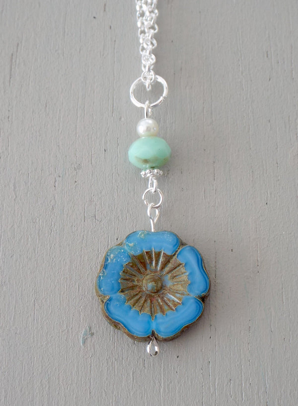 Pendant with 20mm blue carved floral disc, mint & ivory beads