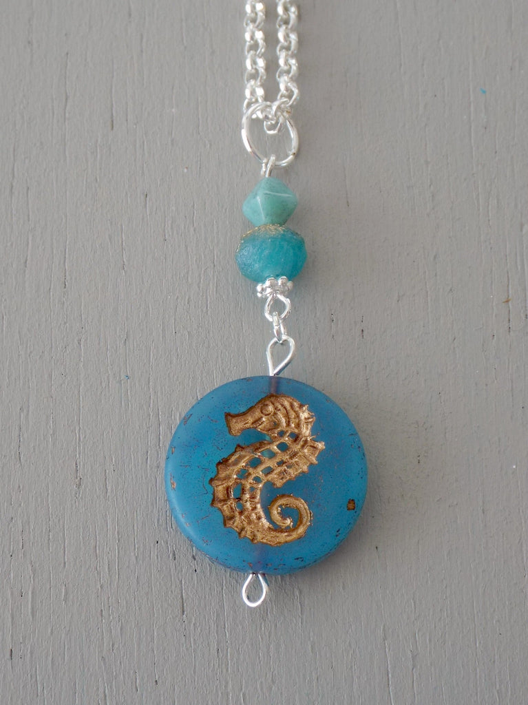 Pendant with 20mm blue gold-carved seahorse coin pendant, blue accents