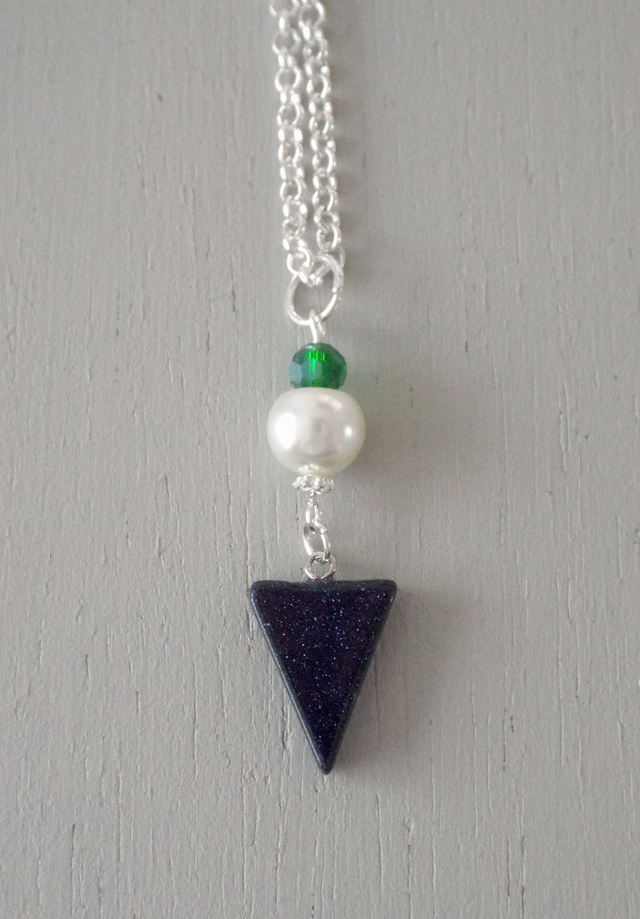 Pendant with 29x15mm blue goldstone triangle, ivory pearl / sparkly green mini