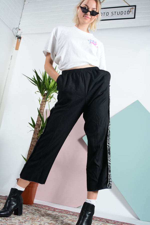 Reworked trousers with animal print trim