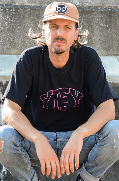 Black YIFY T-shirt with pink outline logo