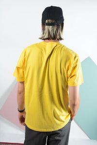 Yellow YIFY T-shirt with pink outline logo