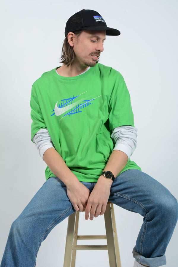 Vintage 90s Nike T-shirt in Green with Graphic Print - 3XL
