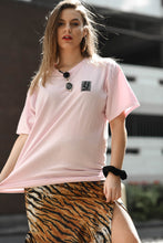 Load image into Gallery viewer, Pink t-shirt with wavey print