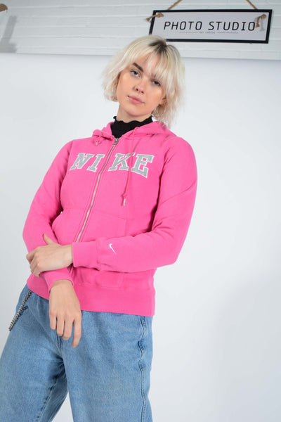 Vintage NIKE Hoodie in Pink with Spell Out Logo - M
