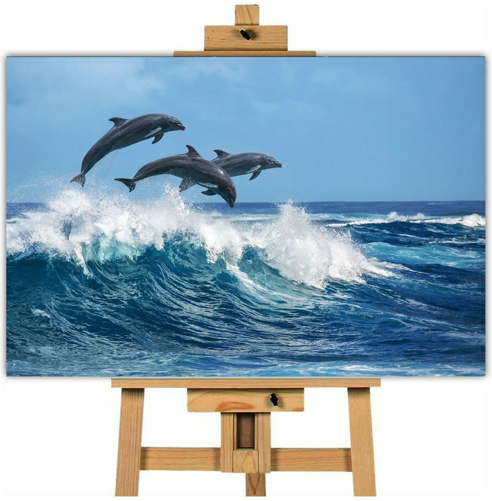 Three dolphins jumping in the ocean canvas wall art print tdj