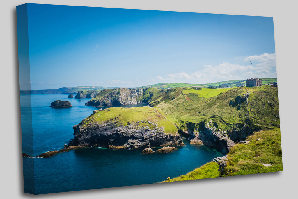 Merlin's Cave, green rocky cliffs, dramatic landscape with Atlantic Ocean / Celtic Sea view from Tintagel castle island in Cornwall, United Kingdom, UK. Canvas Wall Art Picture Print