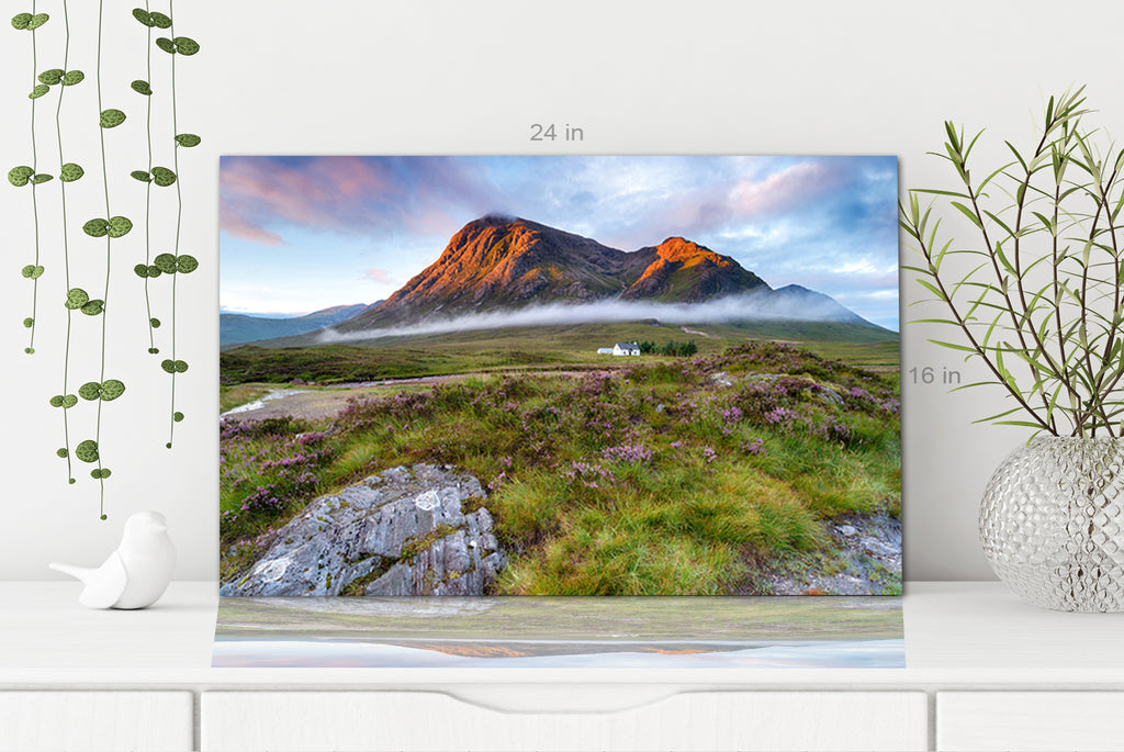 Sunrise over the mountain tops at Glencoe in the highlands of Scotland Canvas Wall Art Picture Print