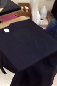 Cured pretreated dark shirt for white ink printing on DTG