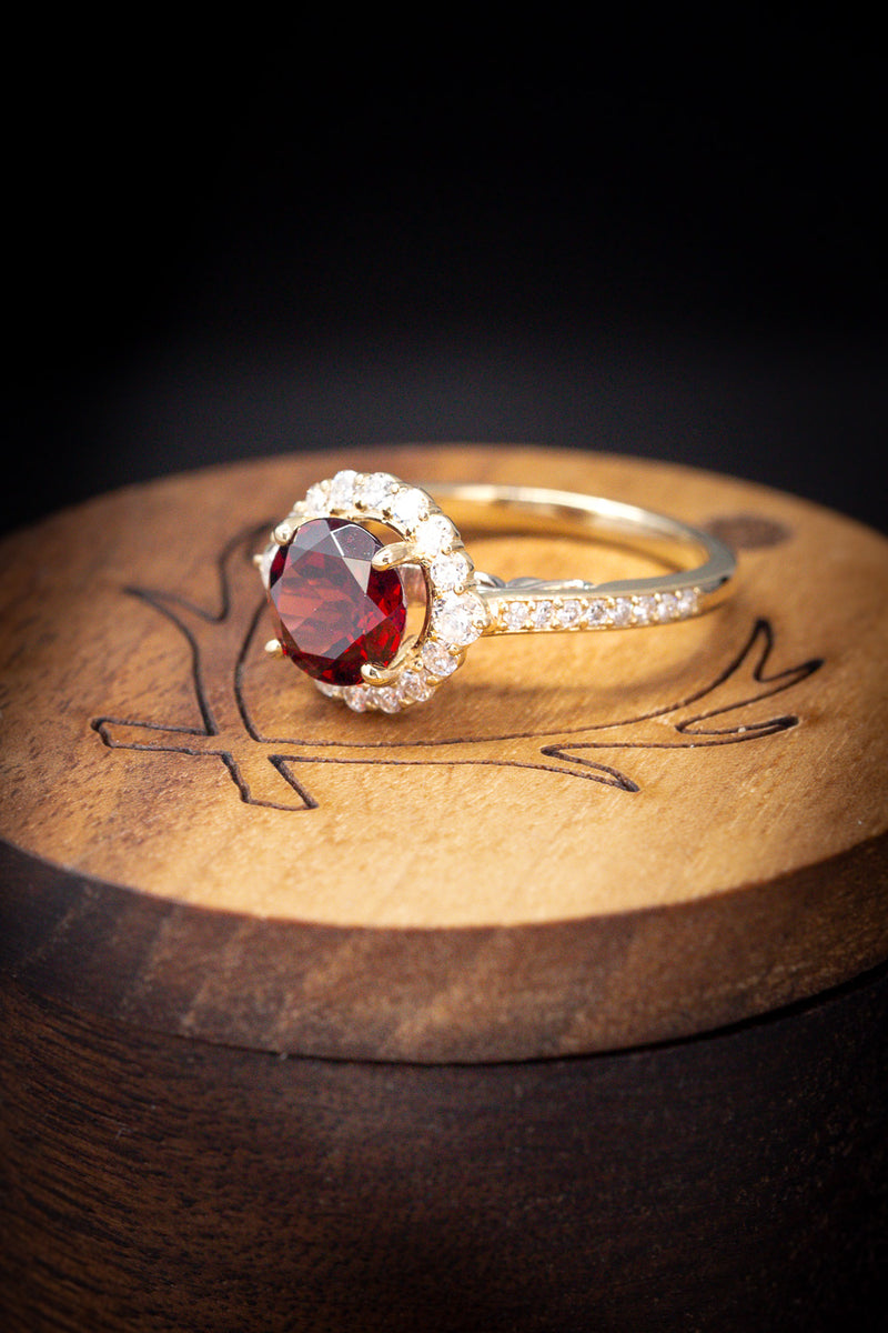 """OPHELIA"" WITH ROUND GARNET CENTER STONE AND DIAMOND HALO & ACCENTS (fully customizable)"