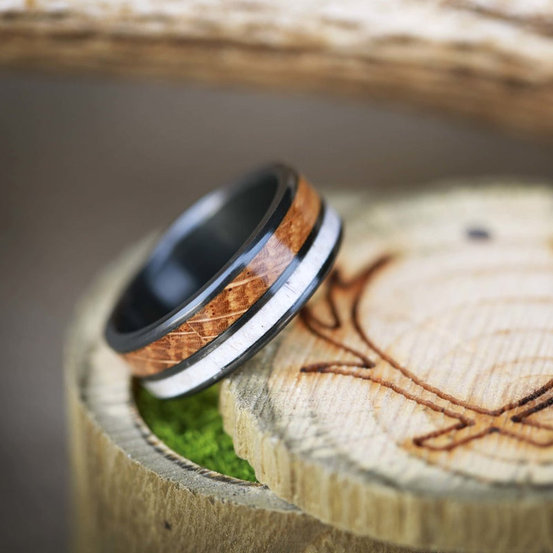 WHISKEY BARREL OAK & ELK ANTLER ON BLACK ZIRCONIUM (available in titanium, silver, black zirconium, damascus steel & 14K white, yellow, or rose gold) -  Custom Rings Handcrafted By Staghead Designs