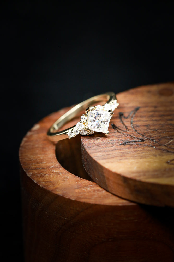 PRINCESS CUT MOISSANITE ENGAGEMENT RING WITH DIAMOND ACCENTS ON A 14K GOLD BAND (fully customizable)