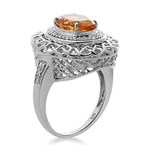 Jewelili Sterling Silver 10x8mm Oval Citrine and 1/10cttw Diamond Halo Ring, Size 7