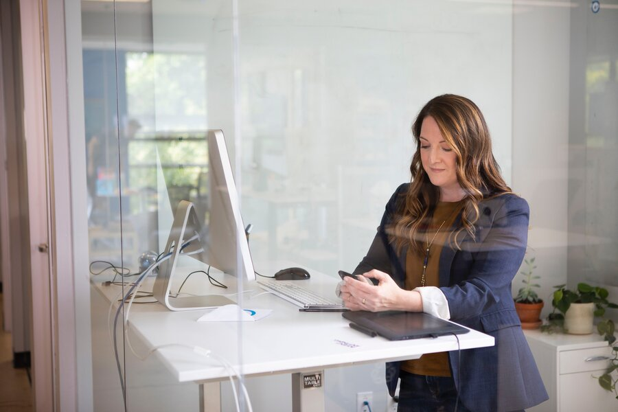 Woman Standing While Working