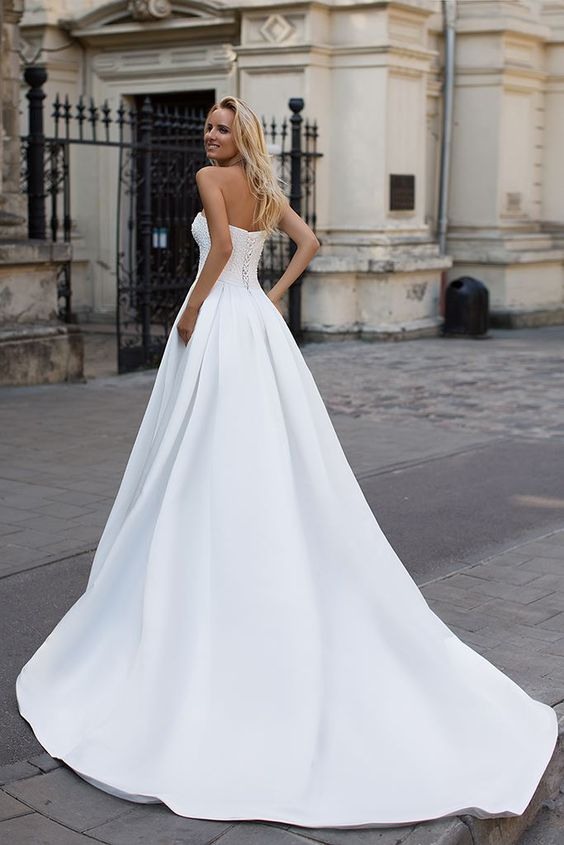 Ballbella custom made you this Simple Strapless White A-line Zipper up A-line Princess Wedding Dress comes in all sizes and colors.Fast delivery worldwide.
