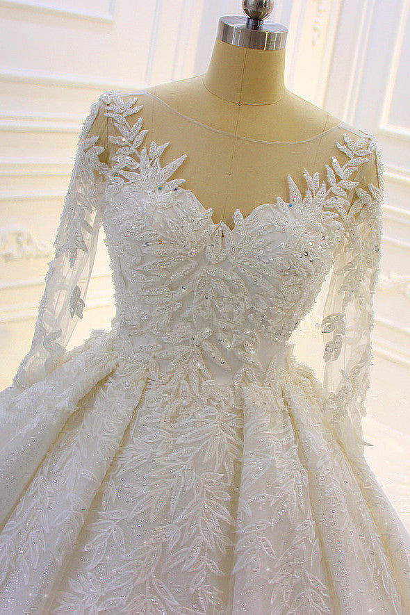 Finding a dress in Tulle, Ball Gown style, and delicate Lace,Beading,Appliques work? Ballbella custom made you this Sparkle 3D Lace Appliques Long Sleevess Church Train Wedding Dress at factory price.