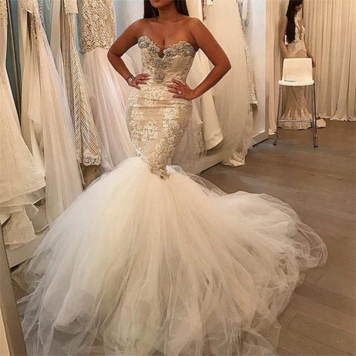 No idea what to wear for your big day? Ballbella custom made you this Tulle Lace Sweetheart Crystal Bridal Gowns at factory price.