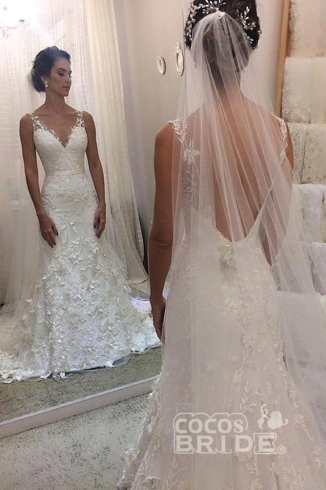 Ballbella offers V-neck sleevless Mermaid White Wedding Dress with Court Train online at an affordable price from Tulle to Column Floor-length skirts. Shop for Amazing Sleeveless wedding collections for your big day.