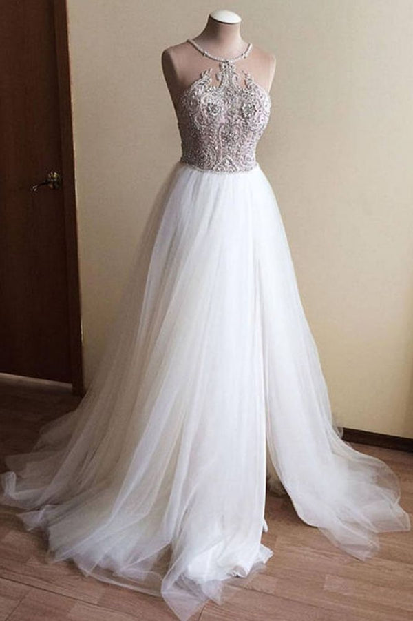 Wanna get a dress in Tulle, A-line style, and delicate Crystal work? We meet all your need with this Classic Halter Illusion neck High split A-line Tulle Princess Wedding Dress at factory price.