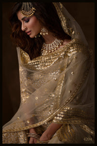 Reception Wear Dusky Beige Net Designer Sharara Suit at Cheapest Prices