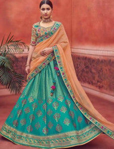 Stylish Kimora KIM6002 Bridal Turquoise Blue Peach Jacquard Silk Lehenga Choli by Fashion Nation