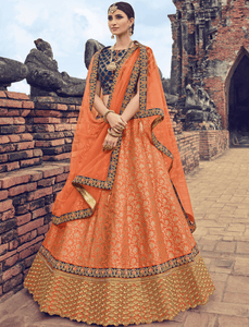 Marvellous LG18038 Charming Orange Jacquard Net Violet Brocade Lehenga Choli by Fashion Nation