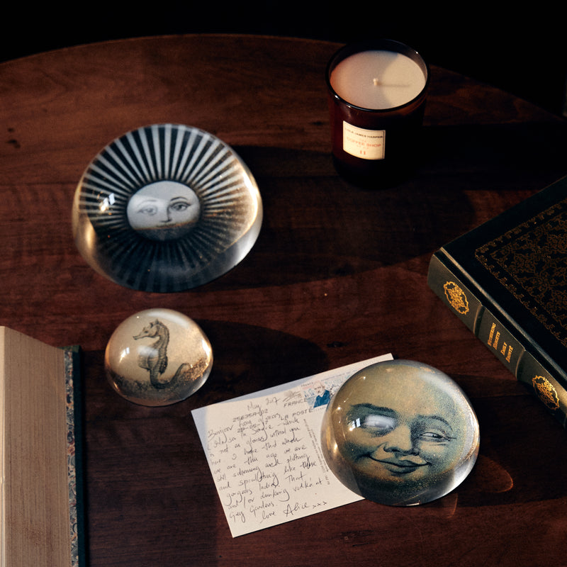 Moon-face paperweight