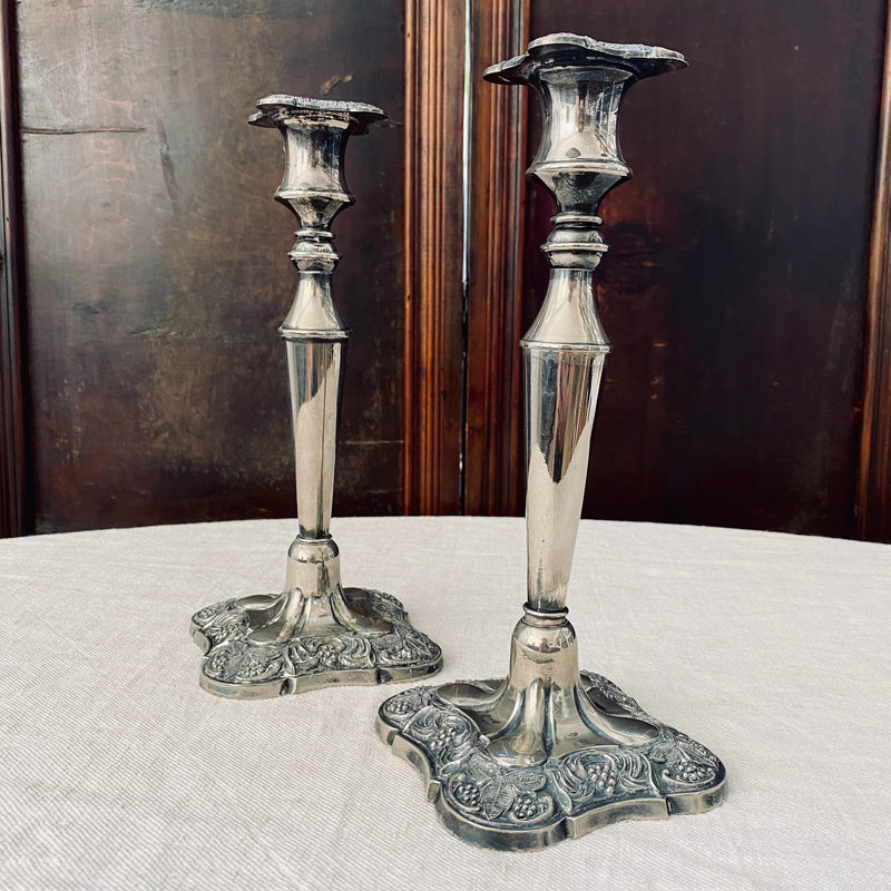 Pair of square-based silver plated candlesticks