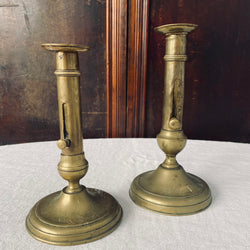Pair of Antique French Brass Ejector Candlesticks, varied heights